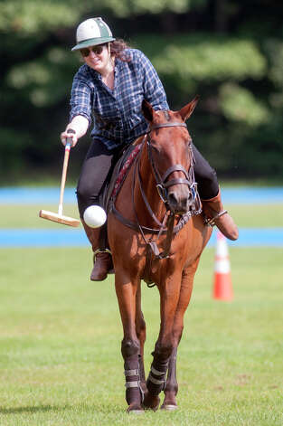 Deanna Fox strikes the polo ball Friday morning, Aug. 8, 2014, at the Saratoga Polo Association grounds in Saratoga Springs, N.Y. (Tom Brenner/ Special to the Times Union) Photo: Tom Brenner / ©Tom Brenner/ Albany Times Union
