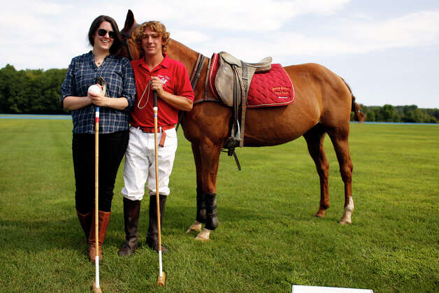 Deanna and Mario pose for a photo Friday morning, Aug. 8, 2014, at the Saratoga Polo Association grounds in Saratoga Springs, N.Y. (Tom Brenner/ Special to the Times Union) Photo: Tom Brenner / ©Tom Brenner/ Albany Times Union