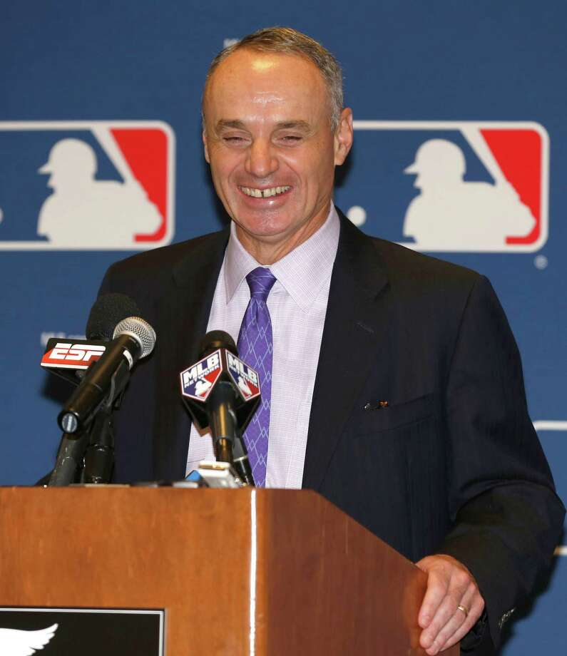 FILE - In this Nov. 14, 2013, file photo, Major League Baseball Chief Operating Officer Rob Manfred talks to the media following baseball's general managers' meetings in Orlando, Fla. Baseball's 30 owners will meet in Baltimore this week to vote on Major League Baseball Commissioner Bud Selig's replacement. A seven-man committee whittled down an expansive list to three candidates: MLB Chief Operating Officer Rob Manfred, Boston Red Sox Chairman Tom Werner and MLB Executive Vice President of Business Tim Brosnan. (AP Photo/Reinhold Matay, File) ORG XMIT: NY169 Photo: Reinhold Matay / FR156687 AP