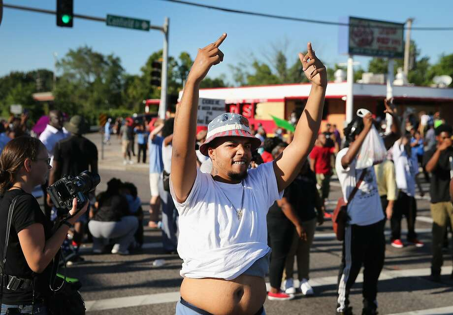 Demonstrators protesting the shooting death of teenager Michael Brown yell at police on August 13, 2014 in Ferguson, Missouri. Brown was shot and killed by a Ferguson police officer on Saturday. Ferguson, a St. Louis suburb, has experienced three days of violent protests since the killing. Photo: Scott Olson, Getty Images