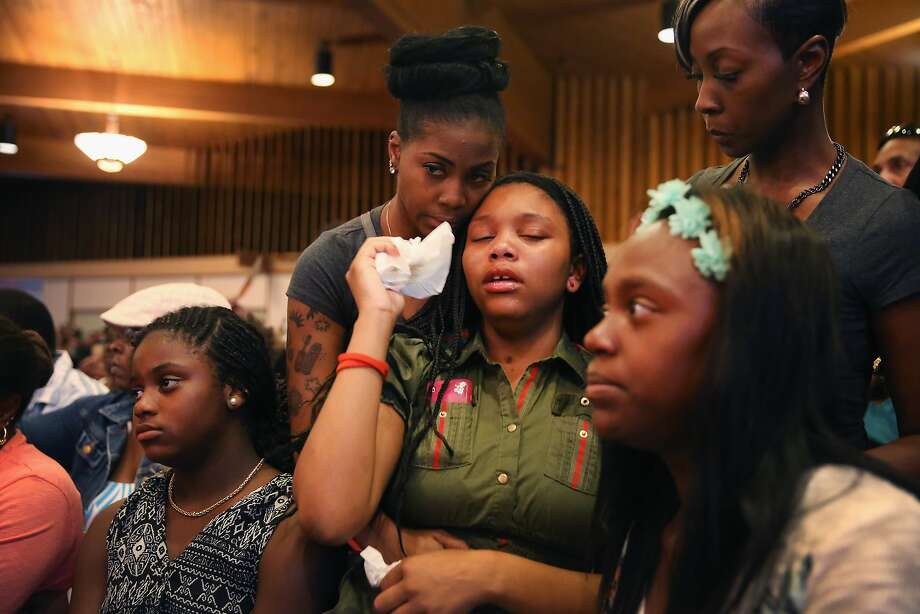 A capacity crowd gathers at Greater St. Marks Family Church along with the family of Michael Brown and civil rights leader Rev. Al Sharpton to discuss the killing of Brown and the civil unrest resulting from his death on August 12, 2014 in St Louis, Missouri. Brown was shot and killed by a police officer on Saturday in the nearby suburb of Ferguson. Ferguson has experienced two days of violent protests since the killing but, tonight the town remained mostly peaceful.  Photo: Scott Olson, Getty Images