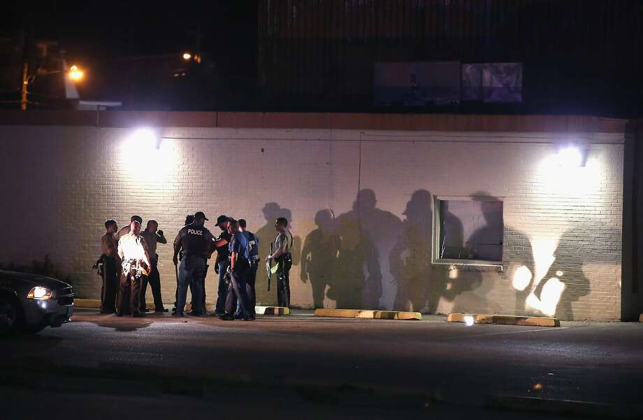 Police detain a man on August 12, 2014 in Ferguson, Missouri. Ferguson has been on edge since the killing by a police officer of teenager Michael Brown on Saturday. Ferguson has experienced two days of violent protests since the killing but, tonight the town remained mostly calm.  Photo: Scott Olson, Getty Images