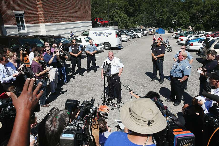 Police Chief Thomas Jackson fields questions related to the shooting death of teenager Michael Brown during a press conference on August 13, 2014 in Ferguson, Missouri. Brown was shot and killed by a Ferguson police officer on Saturday. Ferguson has experienced three days of violent protests since the killing. Photo: Scott Olson, Getty Images