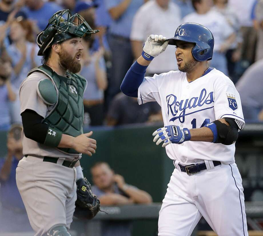By the time Omar Infante (right) hit his third-inning homer, Oakland had its last baserunner. Photo: Charlie Riedel, Associated Press