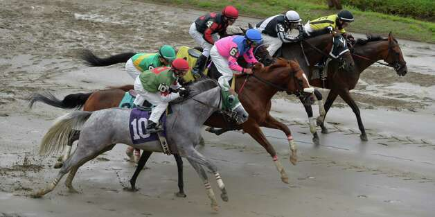 Horse leave the gate on a muddy track during the start of the fourth race on the card Wednesday afternoon, Aug. 13, 2014, at Saratoga Race Course in Saratoga Springs, N.Y.  The race was won by #3 Amulay ridden by John Velazquez and owned by local businessman Roddy Valente.  (Skip Dickstein/Times Union) Photo: SKIP DICKSTEIN