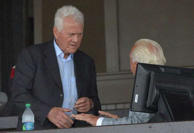 Race track owner Frank Stronach, left,  made a visit to the Saratoga Race Course and was seated with horse owner and former racing commissioner Dr. Jerry Bilinski, right, Wednesday afternoon Aug. 13, 2014 in Saratoga Springs, N.Y.   Stronach's company owns Santa Anita, Pimlico and Gulfstream Park. (Skip Dickstein/Times Union) Photo: SKIP DICKSTEIN