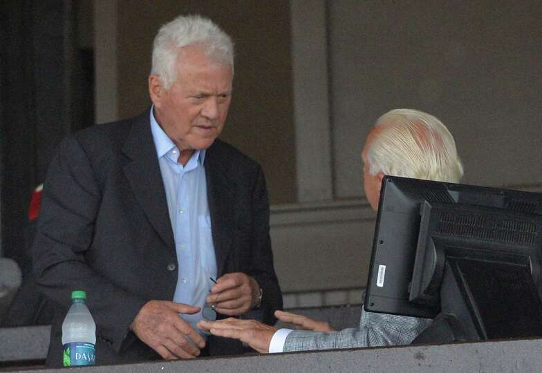 Race track owner Frank Stronach, left,  made a visit to the Saratoga Race Course and was seated with