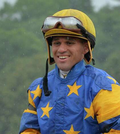 Jockey Javier Castellano is all smiles after he rode Spring to the Sky to the win in the 11th running of the Troy Stakes Wednesday afternoon Aug. 13, 2014 at the Saratoga Race Course in Saratoga Springs, N.Y.    (Skip Dickstein/Times Union) Photo: SKIP DICKSTEIN