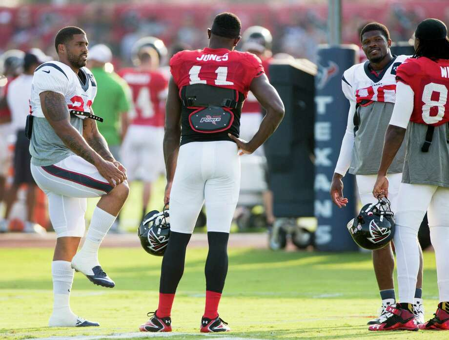 With the return to practice of running back Arian Foster, left, and wide receiver Andre Johnson, second from right, the Texans brought back the star power Wednesday when they hosted Julio Jones (11) and his Falcons teammates at the Methodist Training Center. Photo: Brett Coomer, Staff / © 2014 Houston Chronicle