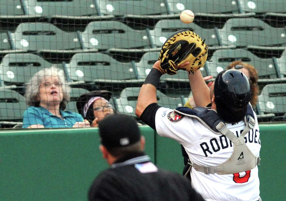 ValleyCats catcher Jake Rodriguez catches a pop up behind home plate during their baseball game against the Hudson Valley Renegades at Joe Bruno Stadium on Wednesday Aug.13, 2014 in Troy, N.Y. (Michael P. Farrell/Times Union) Photo: Michael P. Farrell / 00028114A