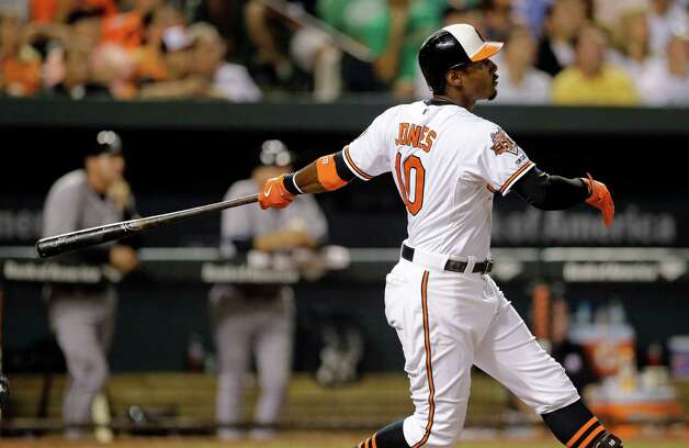 Baltimore Orioles' Adam Jones watches his three-run home run in the eighth inning of a baseball game against the New York Yankees, Wednesday, Aug. 13, 2014, in Baltimore. Baltimore won 5-3. (AP Photo/Patrick Semansky) ORG XMIT: MDPS113 Photo: Patrick Semansky / AP