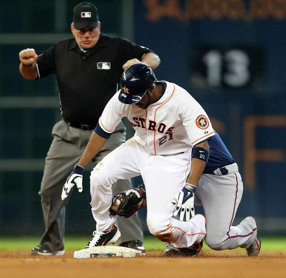 Dexter Fowler (21), who returned from the DL on Wednesday after missing 40 games, is tagged out at second by Twins shortstop Eduardo Escobar after trying to stretch his sixth-inning single into a double. Photo: Karen Warren, Staff / © 2014 Houston Chronicle