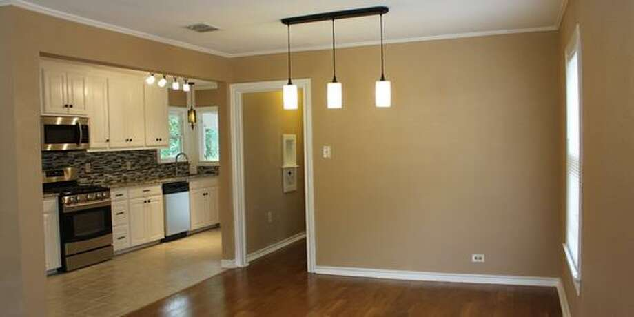 329 QUEEN ANNE CT San Antonio, TX 78209 3 BEDS 2 BATHS  1,526 SQFT  $274,900  BUILT: 1941 MLS ID 1069095  Adorable home in desirable Mahncke Park. Gorgeous hardwood  floors in living room and bedrooms. Updated kitchen; new stainless steel  appliances, tiled backsplash and granite countertops. Fabulous deck  perfect for entertaining. Character and charm minutes from Downtown.  Walk to museums, parks and restaurants. Updated and move-in ready. Photo: Courtesy