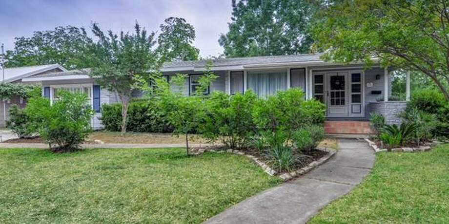 238 HARMON DRSan Antonio, TX 78209 3 BEDS 3 BATHS  1,956 SQFT  $287,000  BUILT: 1948  Adorable cottage with three full baths! The large master is separate with cathedral ceilings, multiple closets, updated bath with double vanity and an adjoining large utility room with work closet. Open floor plan with lots of windows. Two bedrooms and two baths are on the opposite side of the house with floor to ceiling windows. There are gleaming hardwood floors throughout. The saltillo patio makes entertaining delightful. Photo: Courtesy
