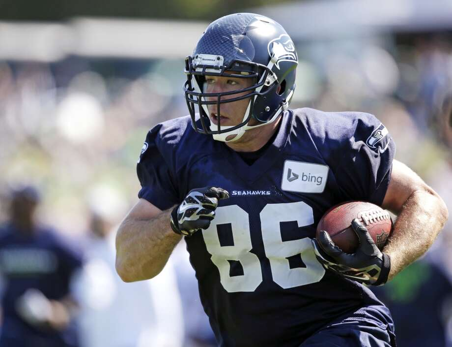 Miller runs at practice during Seahawks training camp on Saturday, July 26, 2014. Photo: Elaine Thompson, Associated Press