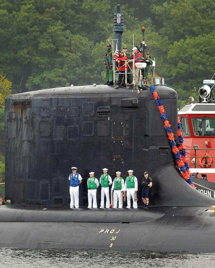 The crew of the Virginia-class attack submarine USS New Hampshire (SSN 778) returns to U.S. Naval Submarine Base New London, Conn. Wednesday, Aug. 13, 2014 after completing a six-month deployment to Europe. The New Hampshire made stops in Norway and England while on deployment after departing Groton on Feb. 11. (AP Photo/Tim Cook, The Day) Photo: Tim Cook, Associated Press
