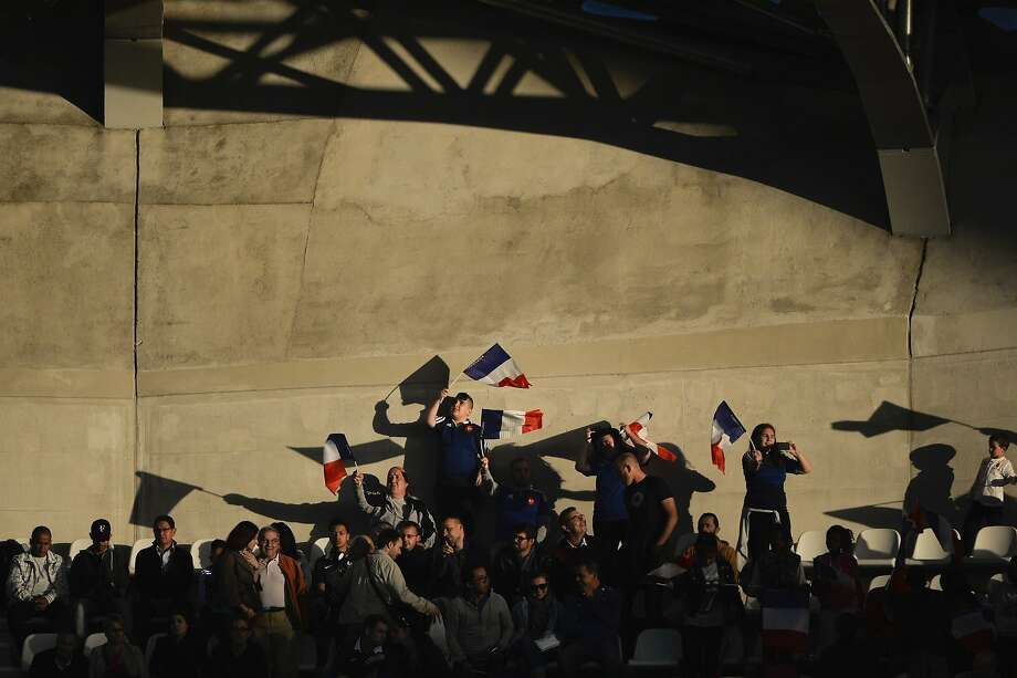 French supporters waves French flags during the IRB Women's Rugby World Cup semi-final match between France and Canada at the Jean Bouin Stadium, on August 13, 2014 in Paris. AFP PHOTO / FRED DUFOURFRED DUFOUR/AFP/Getty Images Photo: Fred Dufour, AFP/Getty Images
