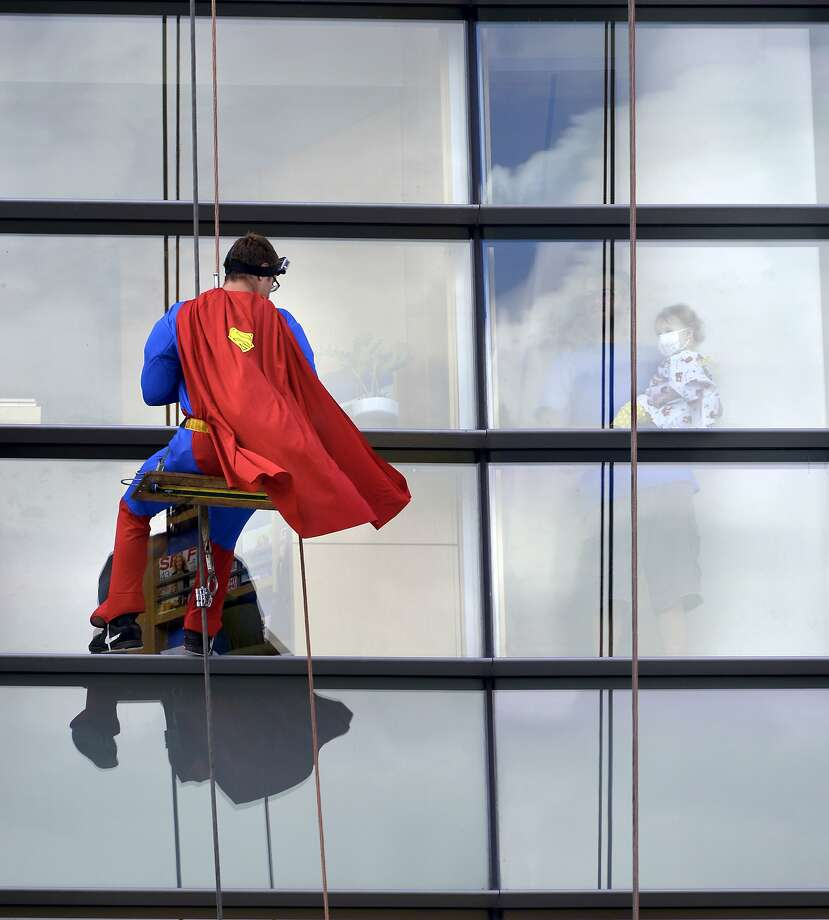 Why don't you just fly, Superman? The Man of Steel rappels down the facade of Penn State Hershey Children's Hospital in order to 