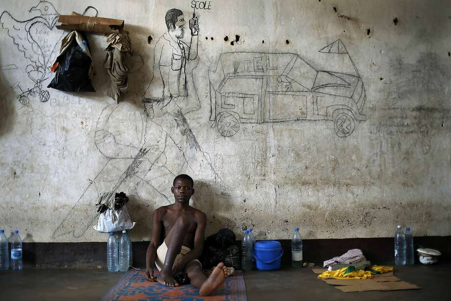 A detainee sits in his cell  in the jailhouse  in Bangui, Central African Republic,  Wednesday June 4, 2014. (AP Photo/Jerome Delay) Photo: Jerome Delay, Associated Press