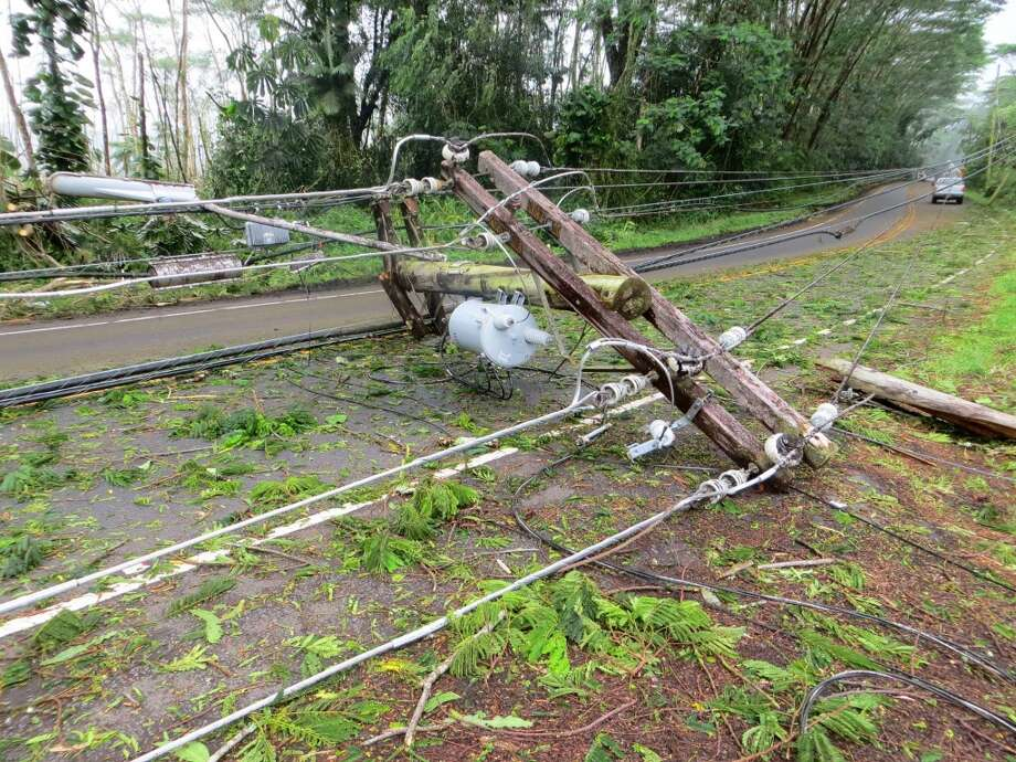 While Puna residents can remove fallen foliage themselves,  downed power lines present a hazard that only utility workers should attempt to remove. Photo: HELCO