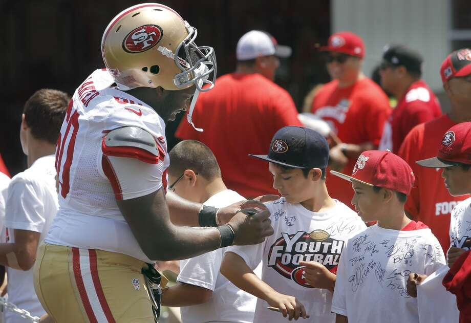 "14. THE PUNT, PASS and KICK COMPETITON: A stock 49ers football tradition. There's always one small kid and a girl who becomes a crowd favorite, a big kid who chokes and an 11-year-old with a great leg --prompting the guy in the next row to remark ""They should sign him to the team!"" Photo: Michael Macor, San Francisco Chronicle"