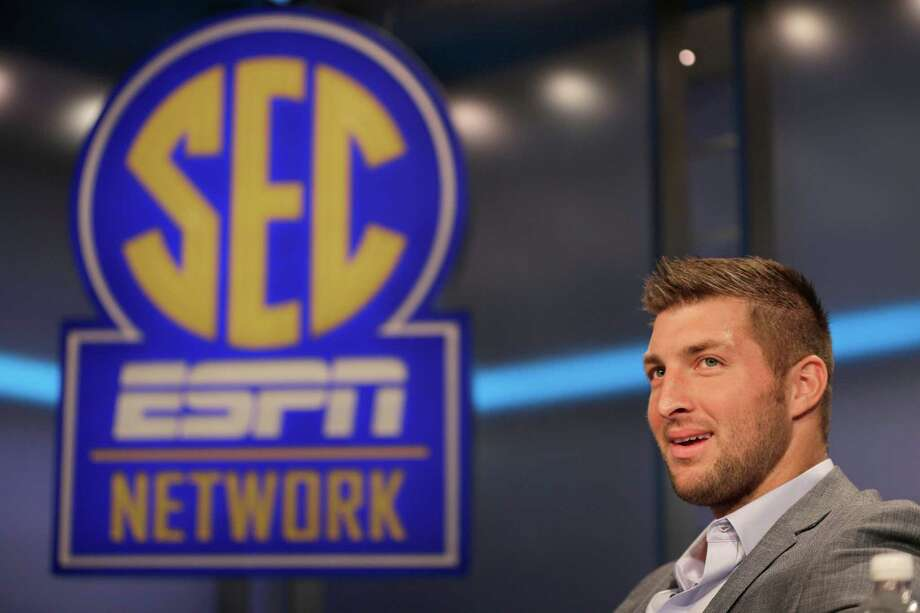Tim Tebow answers a question during a interview on the set of ESPN's new SEC Network in Charlotte, N.C., Wednesday, Aug. 6, 2014. Tebow has a new job as a commentator for the SEC Network, but is still looking for work in the NFL as a quarterback. (AP Photo/Chuck Burton) Photo: Chuck Burton, Associated Press / =Source=
