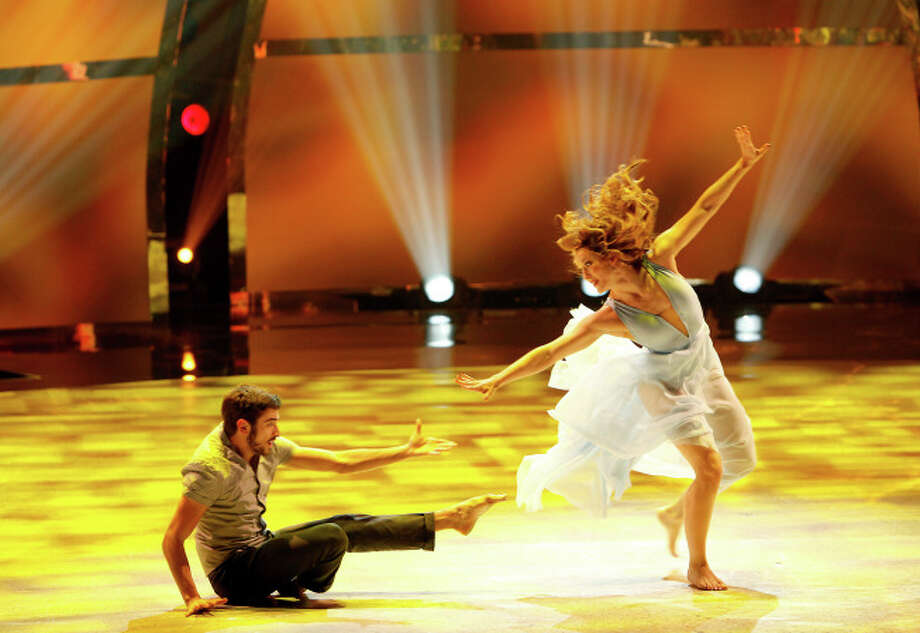 "SO YOU THINK YOU CAN DANCE: Top 8 contestant Ricky Ubeda (L) and all-star Jaimie Goodwin perform a Contemporary routine to ""Smile"" choreographed by Travis Wall on SO YOU THINK YOU CAN DANCE airing Wednesday, August 13 (8:00-10:00 PM ET/PT) on FOX. ©2014 FOX Broadcasting Co. Cr: Adam Rose / 1"