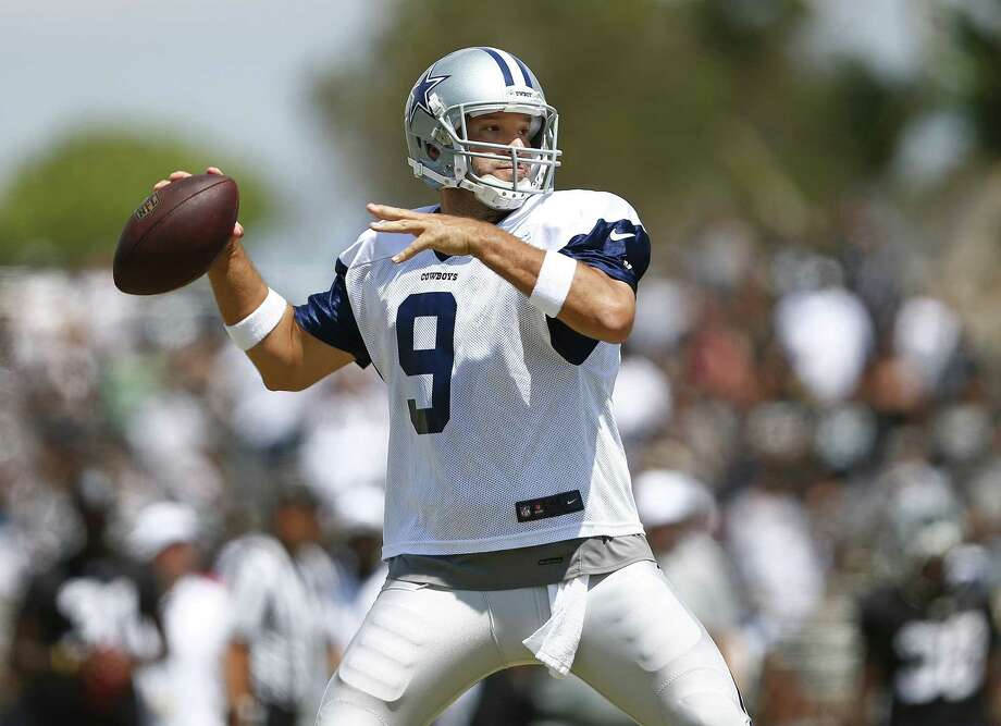 Dallas Cowboys quarterback Tony Romo (9) throws during the Cowboys' training camp on Wednesday, Aug. 13, 2014, in Oxnard, Calif. The Cowboys practiced with the Raiders. (Ron Jenkins/Fort Worth Star-Telegram/MCT) Photo: Ron Jenkins, McClatchy-Tribune News Service / Fort Worth Star-Telegram
