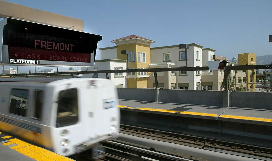 A BART train pulls into the Fruitvale station. Fruitvale Village is right outside the front doors of the station. SB827 would override local density and height limits on apartments and condo buildings up to five stories high if the projects are within a half-mile of major transit hubs. Photo: Michael Macor, The Chronicle