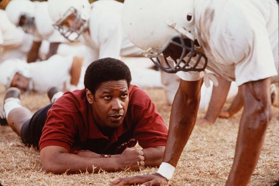 'Remember the Titans' (2000): Denzel Washington stars as the coach of a newly integrated football team in Virginia. Also based on a true story Photo: SFC