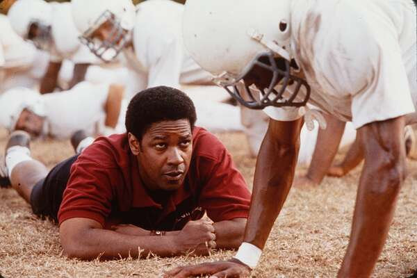 Remember the Titans (2000): Denzel Washington stars as the coach of a newly integrated football team in Virginia. Also based on a true story