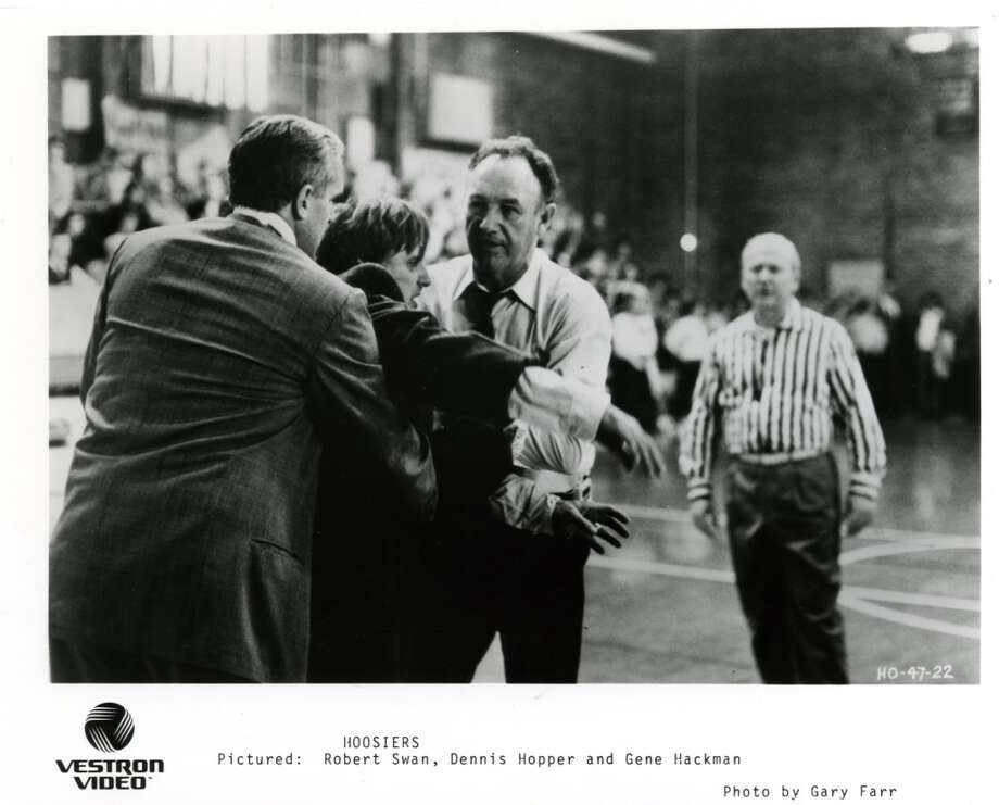 "'Hoosiers' (1986): Based on the true story about a small Indiana town basketball team that ends up winning the state championship. Stars Gene Hackman as the coach and Dennis Hopper as an assistant. Best line: ""Run the picket fence."" Photo: Ho"