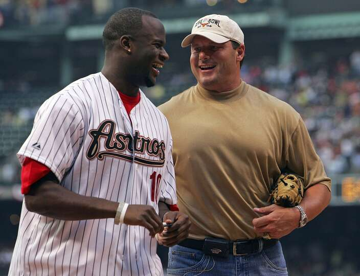 Former UT standouts Vince Young and Roger Clemens visit after Young threw the ceremonial first pitch