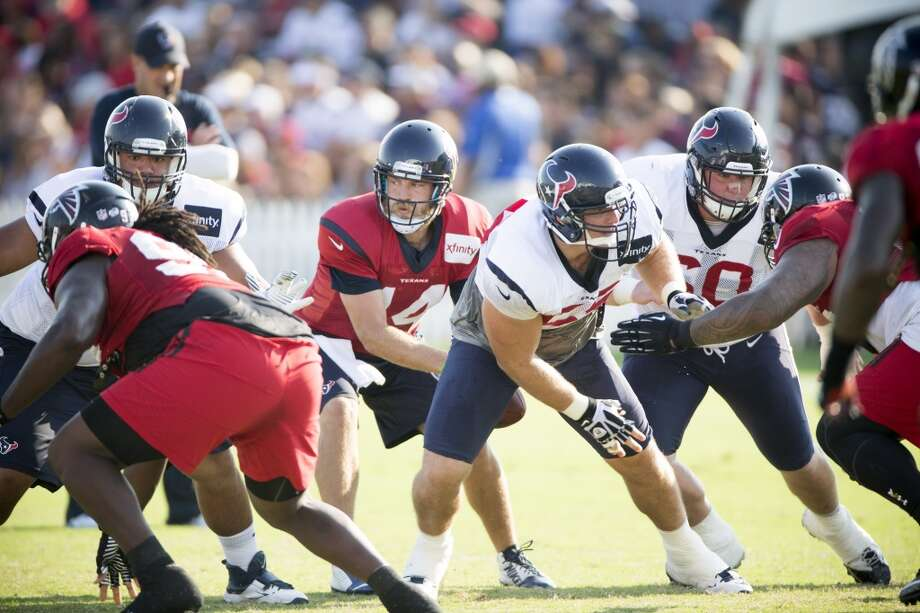 Texans quarterback Ryan Fitzpatrick (14) takes a snap from center Chris Myers (55) while running a play against the Atlanta Falcons. Photo: Brett Coomer, Houston Chronicle
