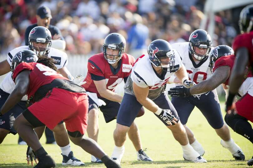Texans quarterback Ryan Fitzpatrick (14) takes a snap from center Chris Myers (55) while running a p