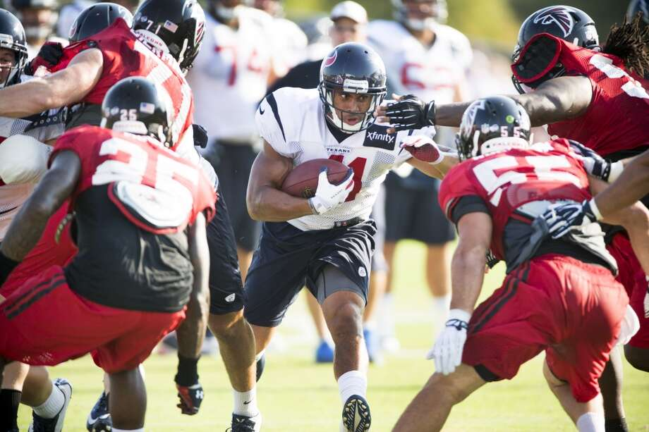 Texans running back Jonathan Grimes (41) runs the ball against the Atlanta Falcons defense. Photo: Brett Coomer, Houston Chronicle