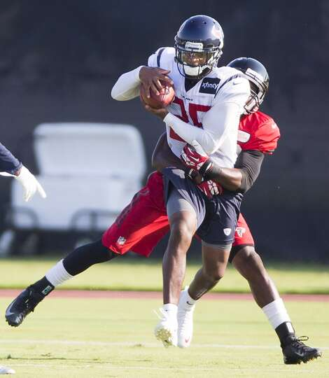 Texans cornerback Kareem Jackson (25) leaps to intercept a pass intended for Atlanta Falcons wide re