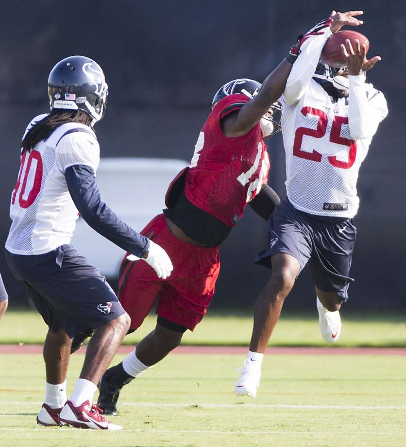 Texans cornerback Kareem Jackson (25) leaps to intercept a pass intended for Atlanta Falcons wide receiver Freddie Martino (18). Photo: Brett Coomer, Houston Chronicle