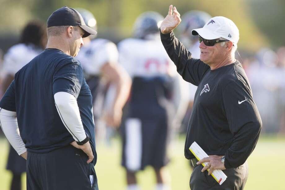 Texans head coach Bill O'Brien, left, talks to Atlanta Falcons head coach Mike Smith during a joint practice. Photo: Brett Coomer, Houston Chronicle
