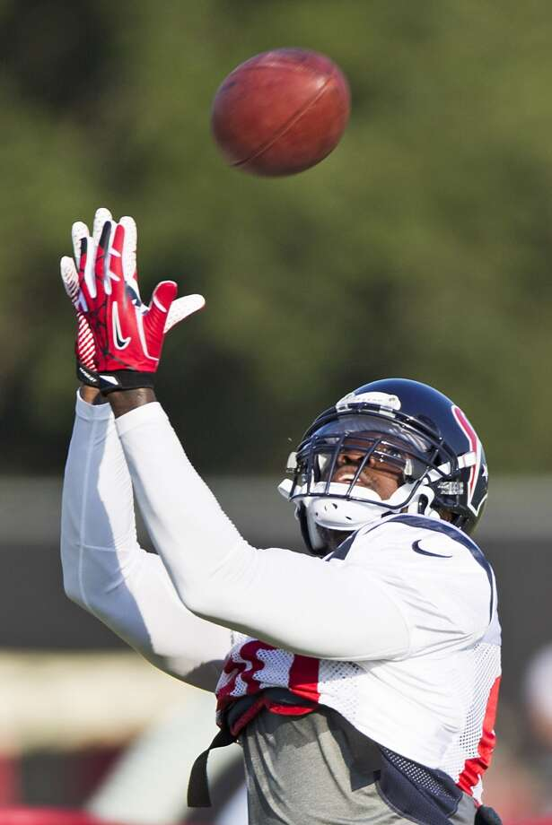 Texans wide receiver Andre Johnson (80) reaches up to make a catch. Photo: Brett Coomer, Houston Chronicle