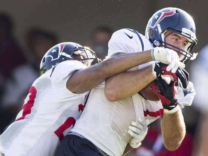 Texans tight end C.J. Fiedorowicz (87) makes a catch with safety Jawanza Starling (29) defending.