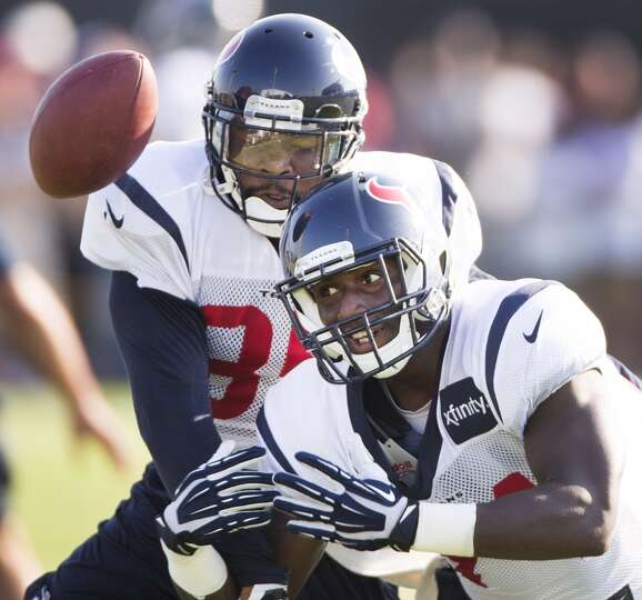 Texans defensive back Eddie Pleasant (35) breaks up a pass intended for running back Alfred Blue (44