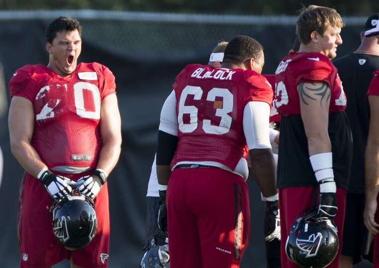 Atlanta Falcons offensive tackle Jake Matthews (70) yawns as he stands with his teammates before the