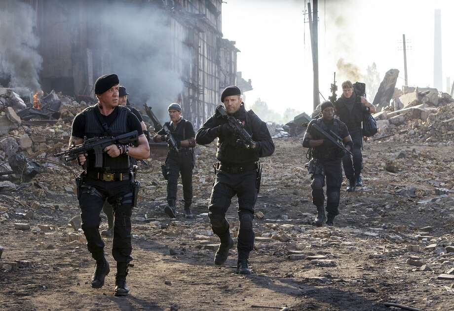 "This image released by Lionsgate shows Sylvester Stallone, left, and Jason Statham, center, in a scene from ""Expendables 3."" (AP Photo/Lionsgate, Phil Bray) Photo: Phil Bray, Associated Press"