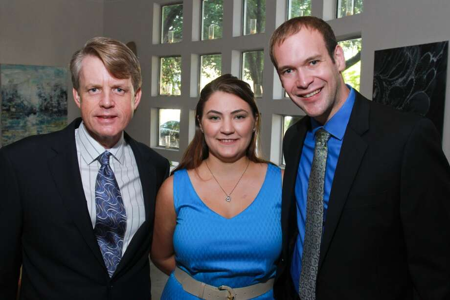 Brian Freeze, from left, with Katherine and Tyler Murphy at the Houston Symphony Young Associates Council Kick-off. Photo: Gary Fountain, For The Chronicle