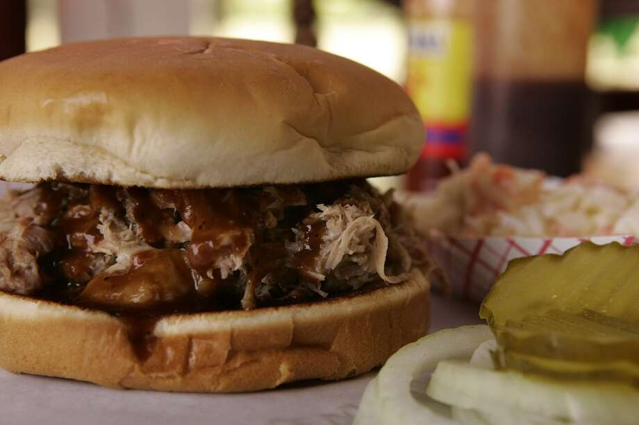 Pulled Pork sandwich at Augie's Barbed Wire Smokehouse (file photo) Photo: KEVIN GEIL, SAN ANTONIO EXPRESS-NEWS