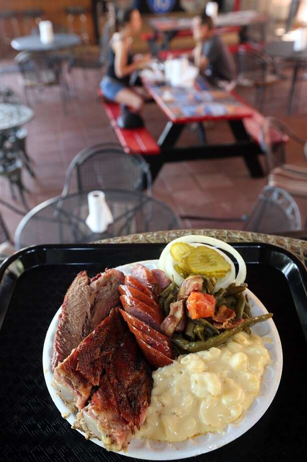 A three-meat plate with brisket, pork ribs and sausage at Augie's Barbed Wire Smokehouse. (Jerry Lara / San Antonio Express-News) Photo: JERRY LARA, San Antonio Express-News