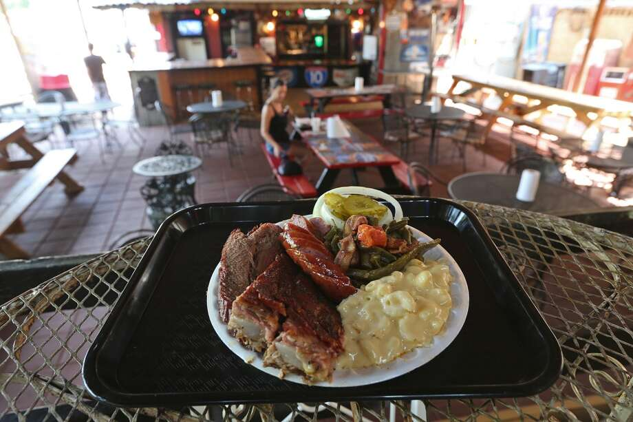 Three-meat plate with brisket, pork ribs and sausage at Augie's Barbed Wire Smokehouse. (Jerry Lara / San Antonio Express-News) Photo: JERRY LARA, San Antonio Express-News