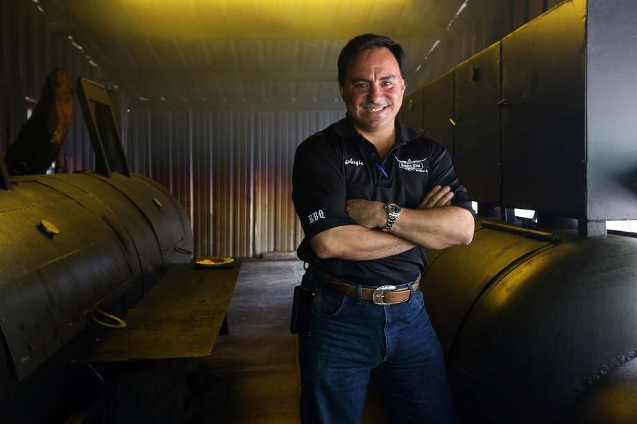 Augie Cortez in the smokehouse at Augie's Barbed Wire Smokehouse. (Jerry Lara / San Antonio Express-News) Photo: JERRY LARA, San Antonio Express-News
