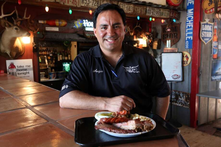Augie Cortez sits in the beer garden at Augie's Barbed Wire Smokehouse. (Jerry Lara / San Antonio Express-News) Photo: JERRY LARA, San Antonio Express-News